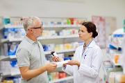 17608506-pharmacist-and-senior-man-buying-drug-at-pharmacy.jpg