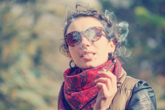 6826228-young-beautiful-woman-smoking-outdoors.jpg
