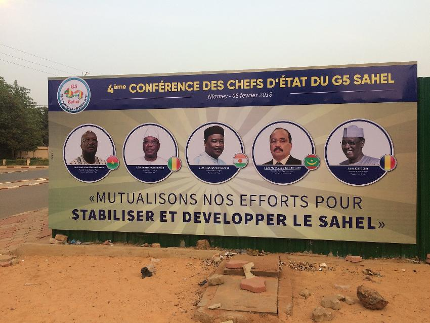 A billboard in Niamey, Niger, announcing a summit of Heads of State, including Chadian President Idriss Déby (first from right), of the G5-Sahel regional security forum, February 2018. [Photo via Wikimedia Commons]