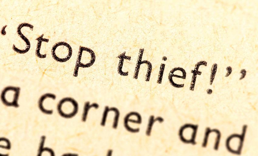 "Bilde av åpen bok med teksten ""stop thief""."