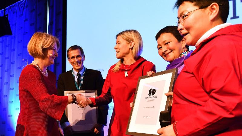 Five smiling people. Photo: Terje Mortensen / Arctic Frontiers